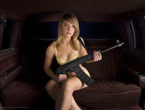 mujer y arma